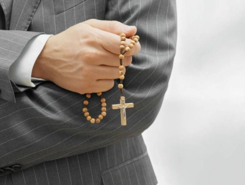 Man holding rosary beads